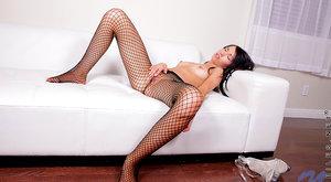 Horny babe in fishnet stockings