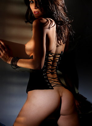 Jenni Lee - is a wild brunette with black fishnets and a corset