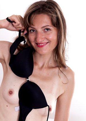Lulu strips off her black lingerie in bed