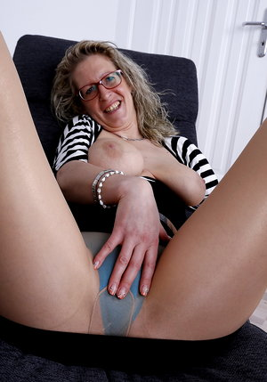 Naughty German housewife showing off her dirty mind