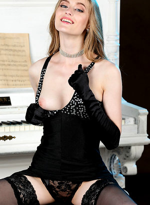 Rebecca G strips her luxurious dress baring her delectable body by the piano.